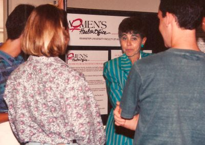 May Cohen discussing the Women's Health Office with students circa 1990